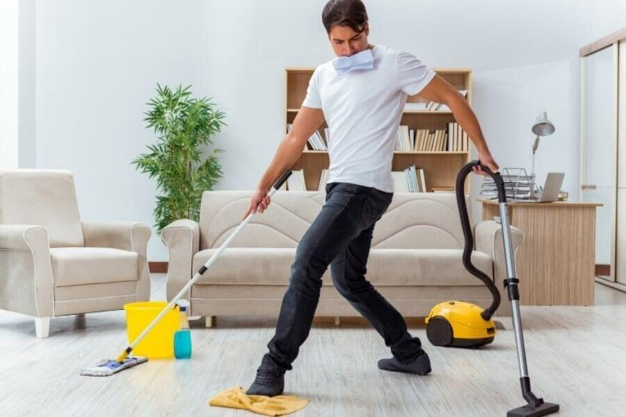 Man cleaning house