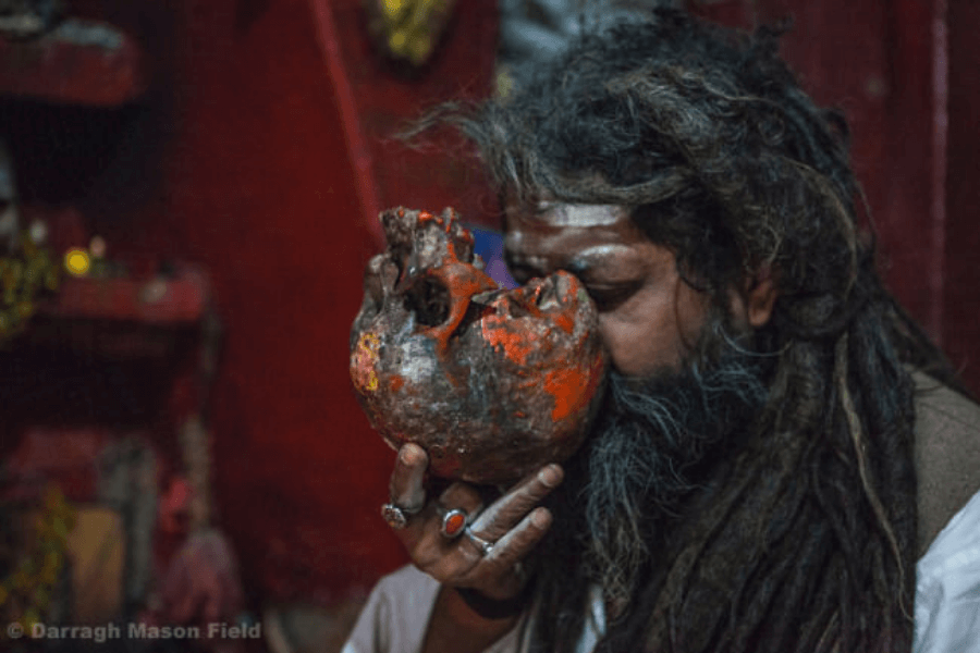 Using a human skull for drinking